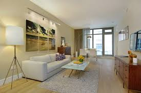 apartments one bedroom apartment decorating with yellow sofa and studio apartment design of white dining set with arch lamp and white loveseat plus cushions