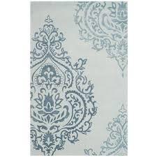 safavieh isaac mizrahi hand tufted light blue dark blue area rug