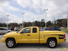 solar yellow 2006 dodge dakota r t club cab exterior photo