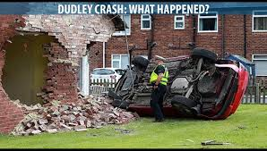 dudley crash car ploughs into side of bungalow leaving two in