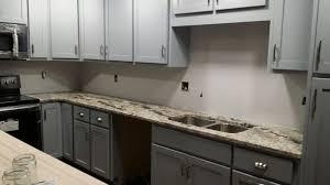 blue kitchen cabinets brown granite brown granite with grey shaker cabinets grey cabinets