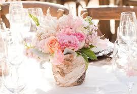 wedding centerpiece in rustic wood vase