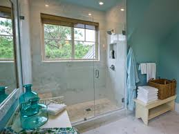 walls of the walk in shower are clad in carrera marble tile while