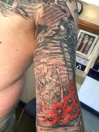 man covers up regretful tattoo with incredible ww1 mural thechive