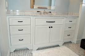 white shaker vanity cabinets with gray glass tile backsplash