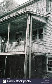 abandoned colonial style house veranda with creepy windows with