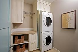 Washer And Dryer Cabinet Calgary Ironing Board Cabinet Laundry Room Traditional With Front