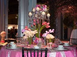 the middle thanksgiving pink tulip flowers with white candles on the glass base plus white