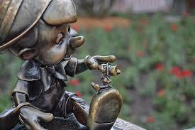 disney pinocchio and jiminy hub statue on us flickr