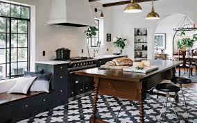 stone island kitchen checkerboard tile floor dark brown leather bar stool broken white