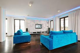 light blue gray blue wall theme and grey fabric sofa plus square dark brown woodne