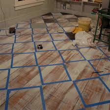 Floor Painting Ideas Wood Use Masking Tape To Mark Out Design For Painting Wooden Floor With