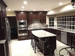 giallo light granite countertop with cherry wood cabinet granite
