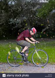 cycling wind man cycling in wind stock photo 283723237 alamy