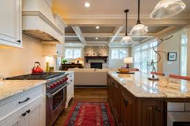 white kitchen cabinets with wood beams open concept kitchen living room wood beams white cabinets
