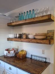 black kitchen cabinets with white countertops two floating thick wooden shelves white kitchen cabinet with dark