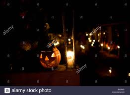 mexico city halloween a plastic halloween pumpkin decorates a tomb at the cemetery in