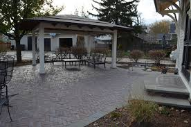 How To Build A Patio With Pavers by 4 Reasons To Replace Your Wooden Deck With A Paver Patio