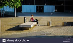 bench berlin berlin may 30 girl sitting alone on a concrete stock photo