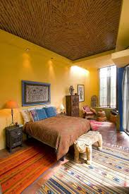 interiors that embrace the warm rustic beauty terracotta tiles vibrant bedroom showcases blend exotic styles and hues design house