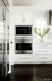 off white kitchen cabinets with stainless appliances buying a microwave 5 things you should know kitchens stove and