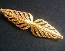 ornamental jewelry etsy