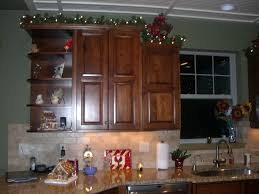 decor for top of kitchen cabinets decorations for above kitchen cabinets photogiraffe me