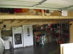 storage loft above garage door the garage journal board garage
