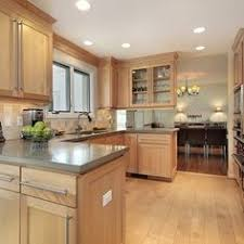 maple kitchen ideas maple cabinets with caeserstone desert limestone counters