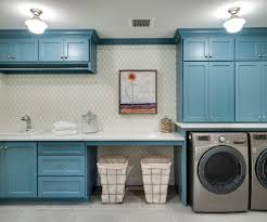 laundry folding table room transitional with blue cabinets
