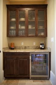 cute brown color wooden kitchen pantry cabinets features wall