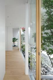 house with floating facade glass walls and interior courtyard