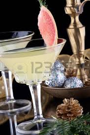 close up of winter grapefruit martini cocktails garnished with