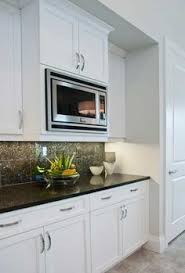 Hide Microwave In Cabinet 9 Kitchen Makeovers That Will Make You Swoon Space Saver Ranges