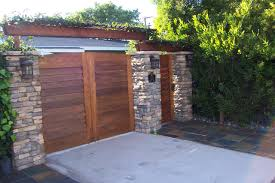 favored stacked stones column fences also brown wooden driveway