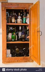 Shelves Built Into Wall Stored Liquor And Wine Bottles Inside A Recessed Pantry Built Into