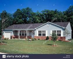 1960s 1970s single story ranch style home with lawn stock photo