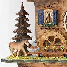 chalet style quartz cuckoo clock with lumberjack and horse 31cm by