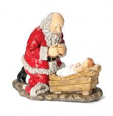 santa and baby jesus kneeling santa with baby jesus statue 12 inch