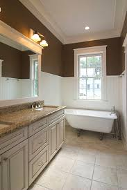 updated bathroom with traditional wainscoting extending fairly