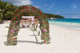 wedding arch leaves wedding arch made of palm tree leaves and flowers before