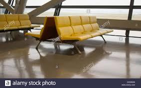 yellow waiting room bench chairs in haneda airport stock photo