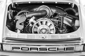 engine porsche 911 1976 porsche 911 2 7 engine taillight emblem photograph by