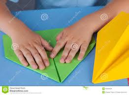 child making a paper plane stock photo image 46090094