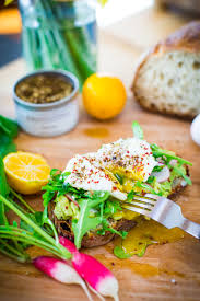 avocado toast with poached eggs arugula and zaatar feasting at