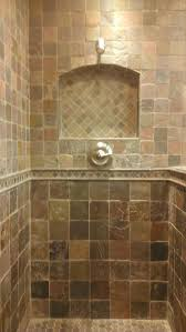 fascinating shower with travertine tile wall completed by small bathroom inspiration picturesque satin nickel mounted single handle shower taps hang on stone patterns tile