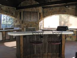 outdoor kitchens and bars built out of galvalume stylish wooden