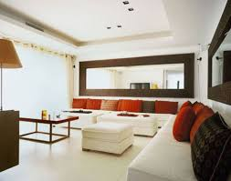 contemporary living room wall ideas with white corner sofa set and