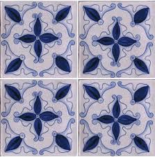 blue and white hand painted tile perfect for a bathroom wall