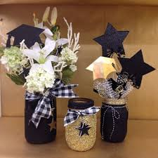 graduation centerpiece ideas graduation centerpiece glittered black and gold masonjar grad